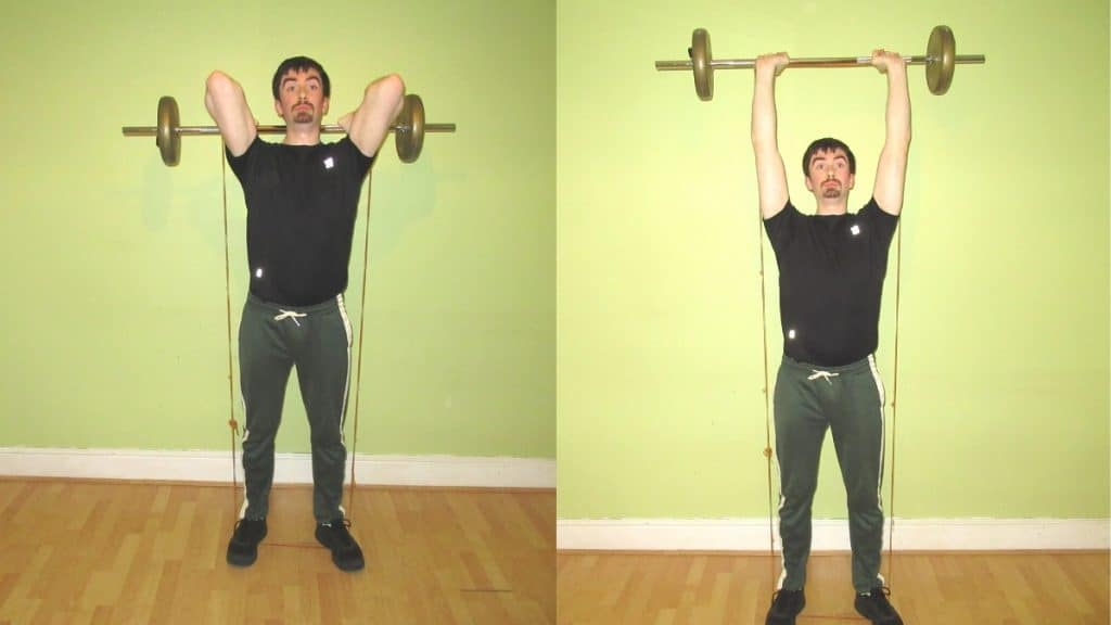 A man performing a banded tricep extension during his strength training workout