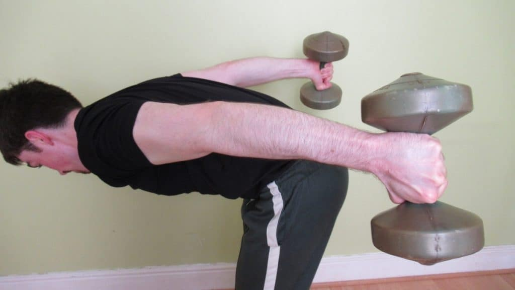 A man doing a bent over arm extension