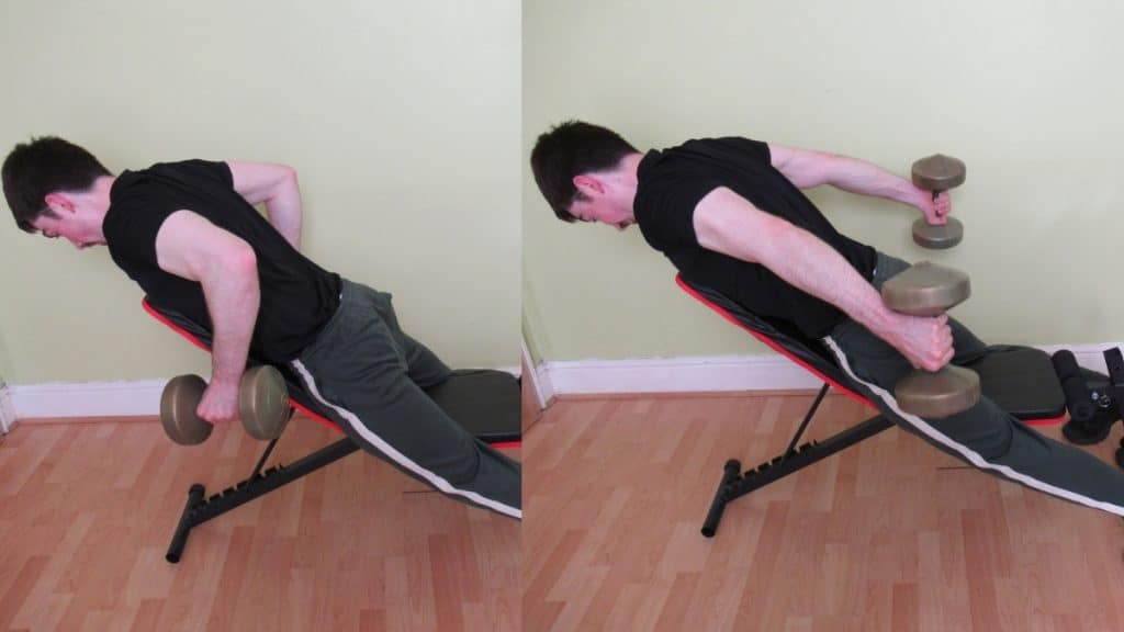 A man doing a bent over tricep extension on a bench