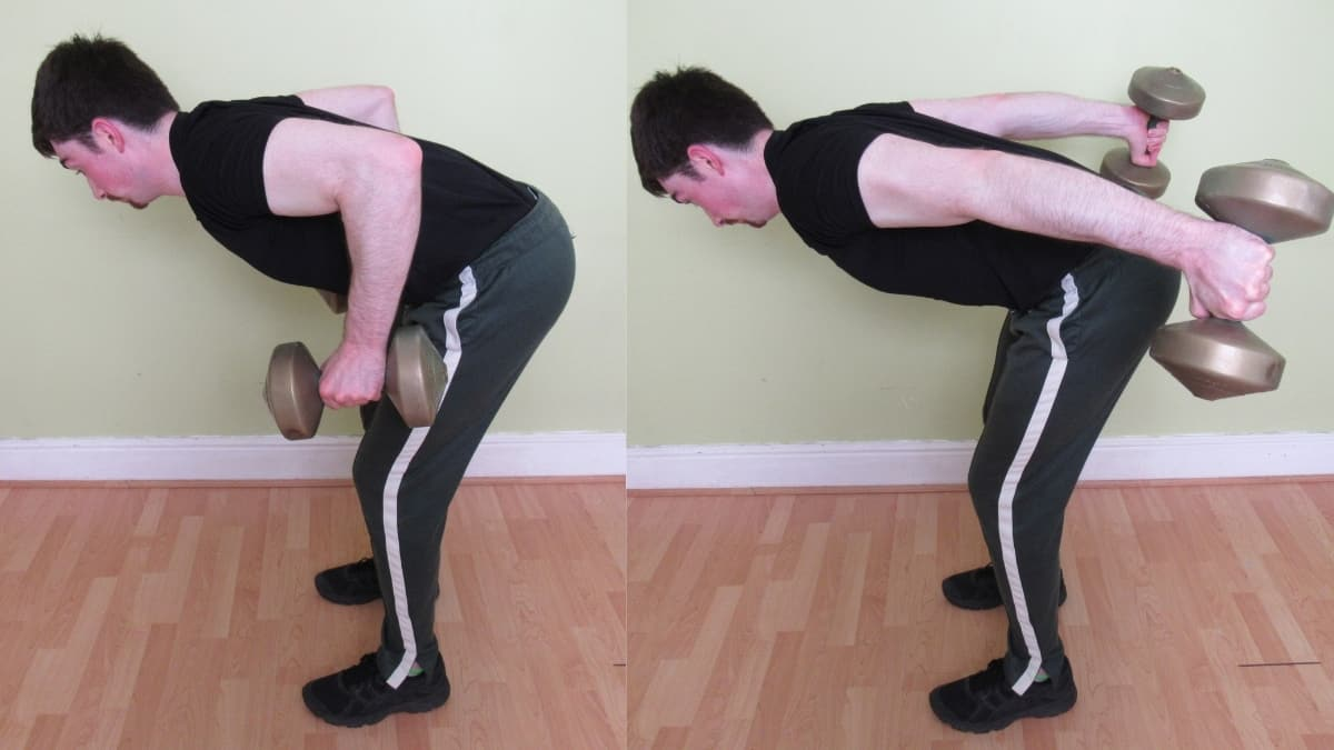 A man performing a bent over tricep extension during his workout