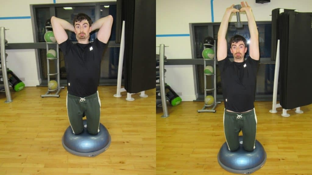 A man doing a BOSU ball kneeling dumbbell tricep-extension