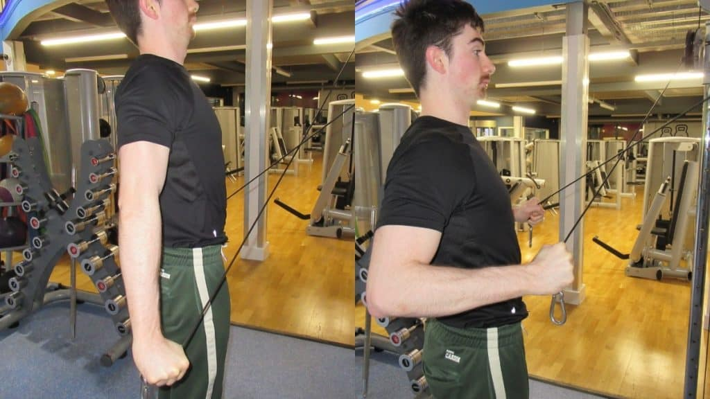 A man demonstrating the peak contraction during a cable cross tricep extension