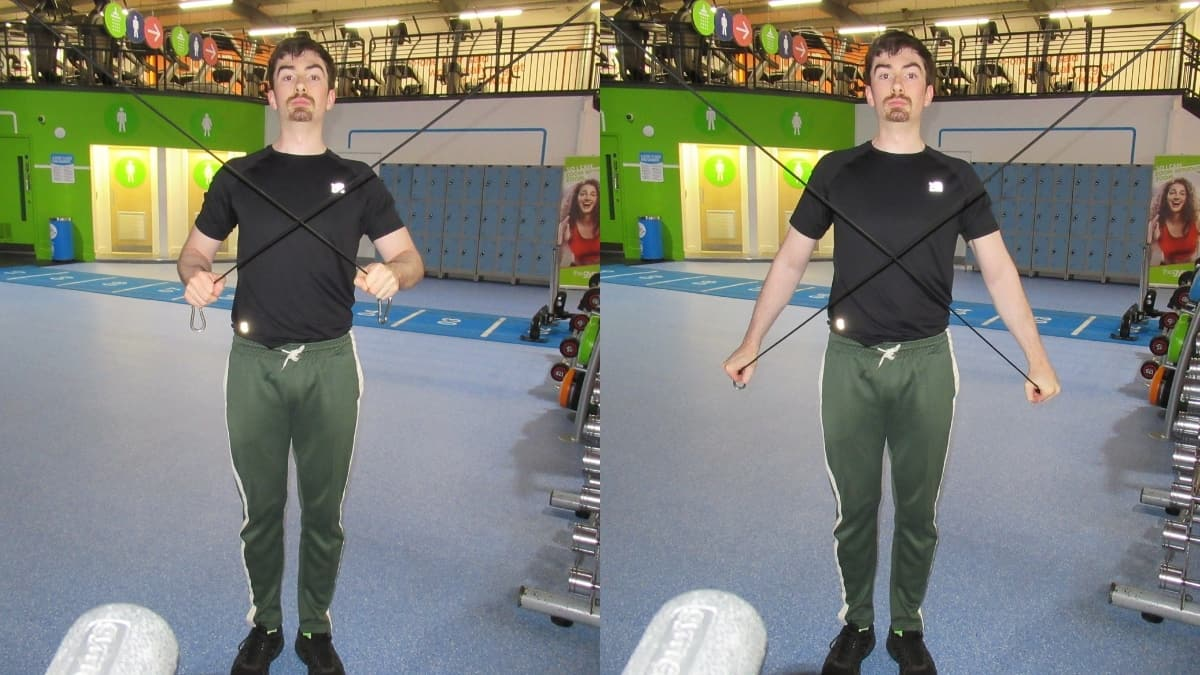 A man performing a cable cross triceps extension at the gym