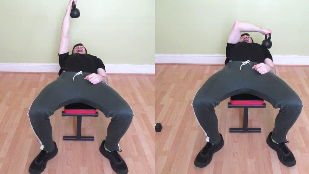 A man doing a cross body kettlebell tricep extension