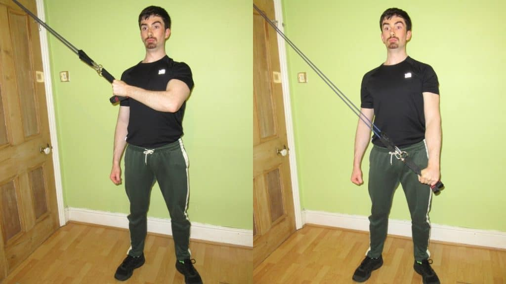 A man performing a cross body resistance band tricep extension