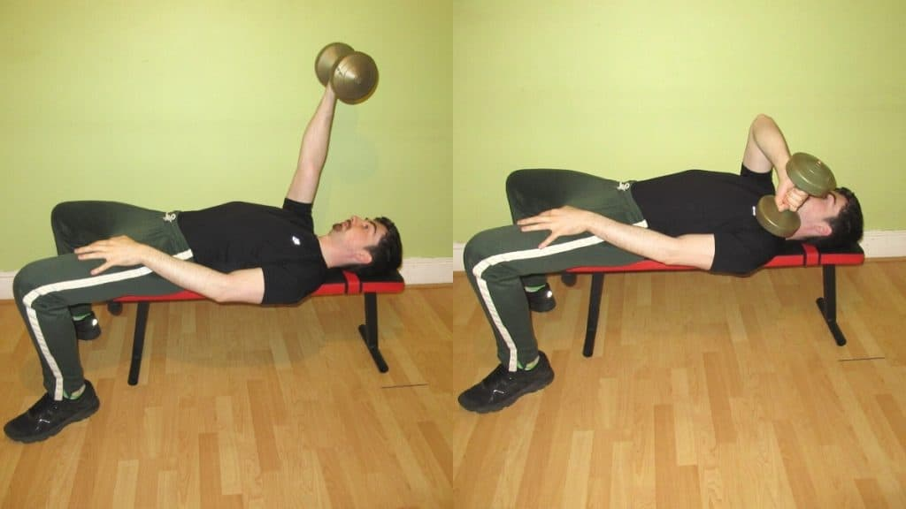 A man performing a lying cross body tricep extension with a dumbbell on a flat bench