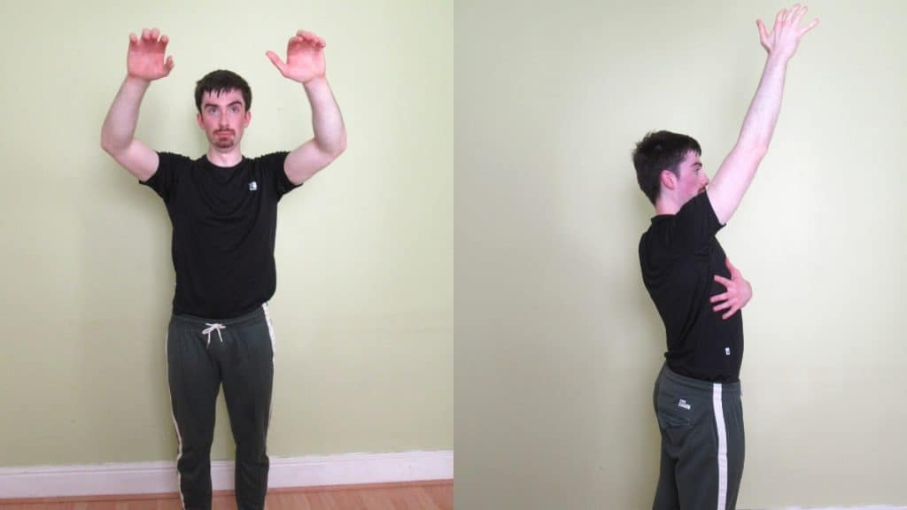 A man warming up his shoulders before a workout
