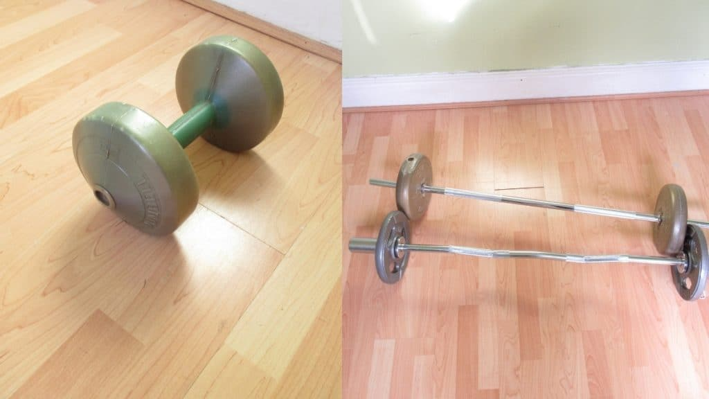 A dumbbell and two barbells on the floor