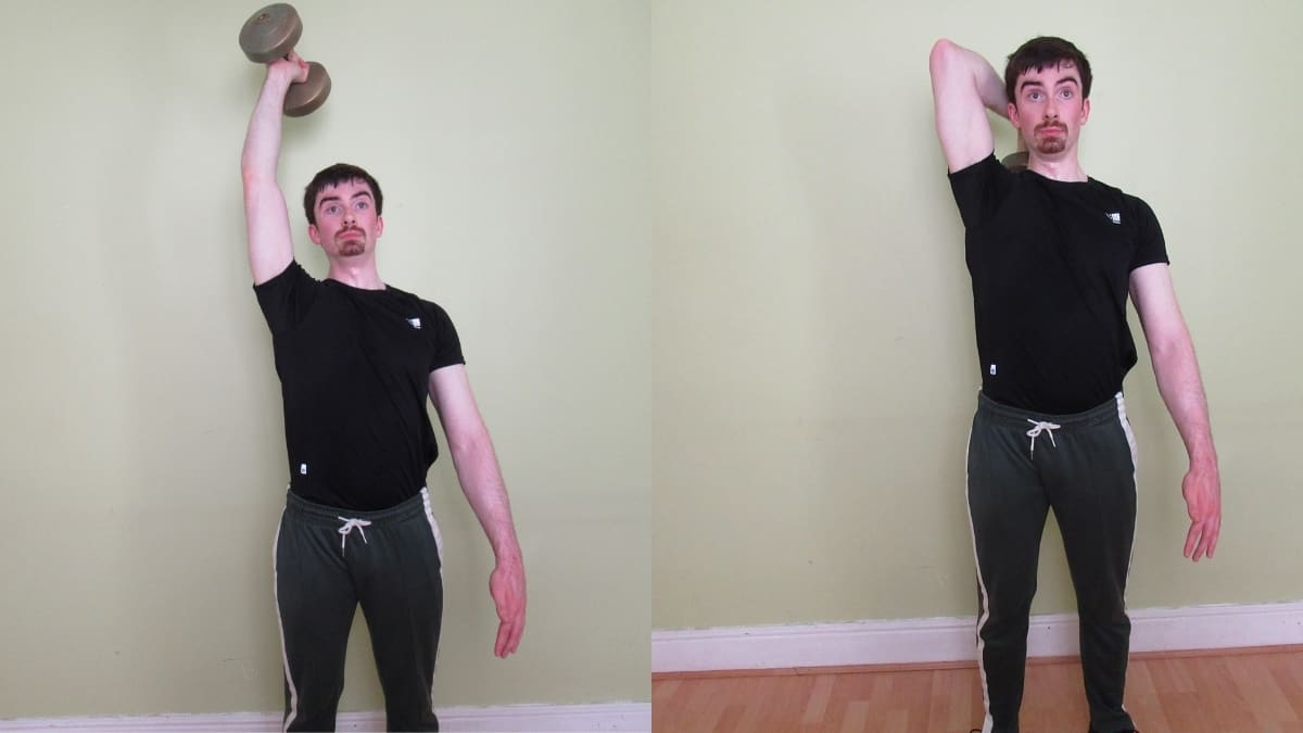 A man performing a standing one arm dumbbell overhead tricep extension