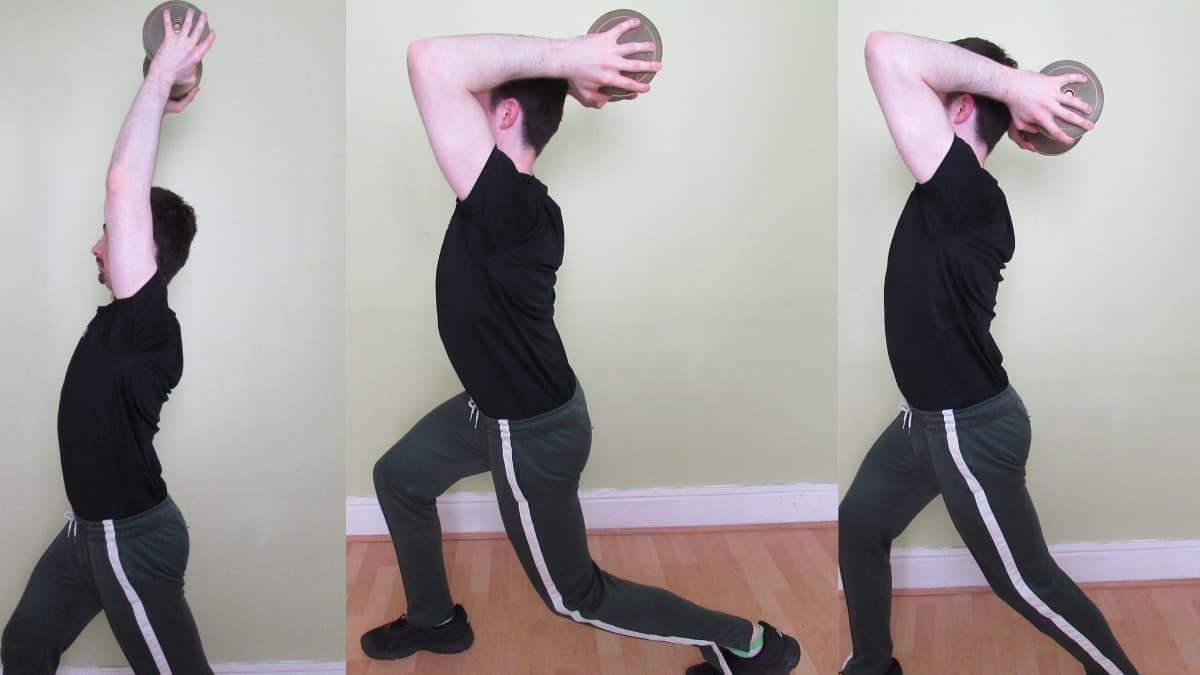 A man performing a dumbbell tricep extension lunge