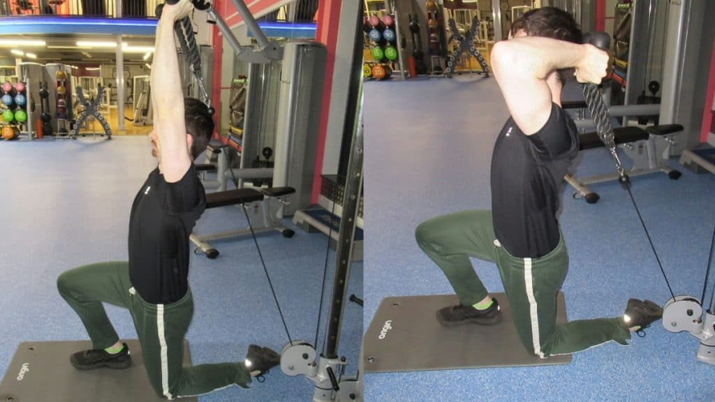 A man doing a half kneeling cable tricep extension