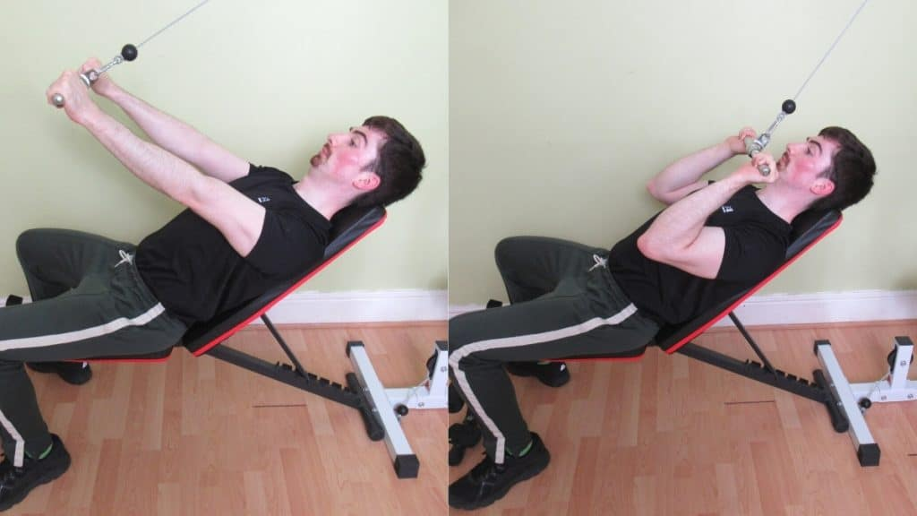 A man performing high incline cable tricep extensions