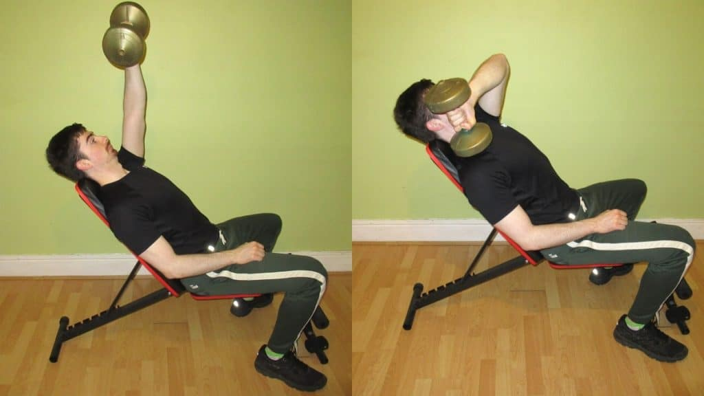 A man doing an incline cross body triceps extension