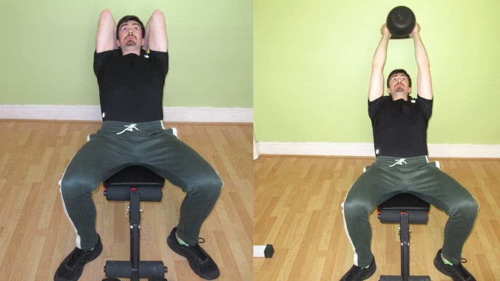 A man doing an incline kettlebell tricep extension