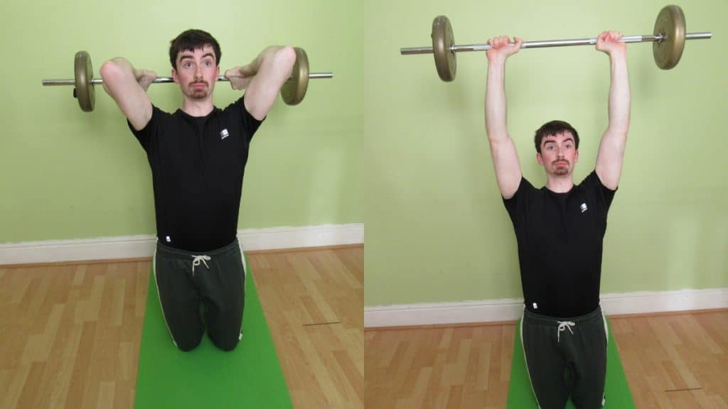 A man doing a kneeling barbell overhead extension for his triceps