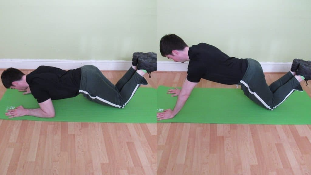 A man doing a kneeling bodyweight tricep extension