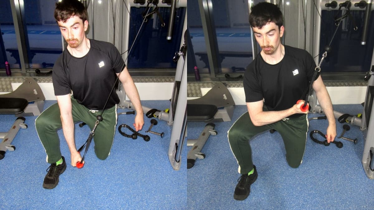 A man doing a kneeling cable concentration triceps extension