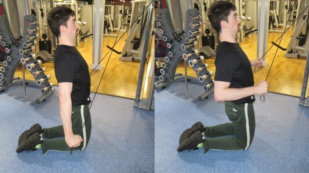 A man doing a kneeling cable crossover tricep extension at the gym