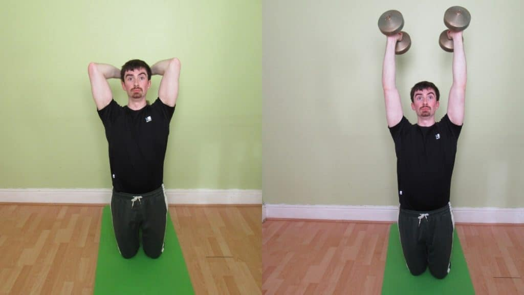 A man performing an overhead kneeling dumbbell tricep extension