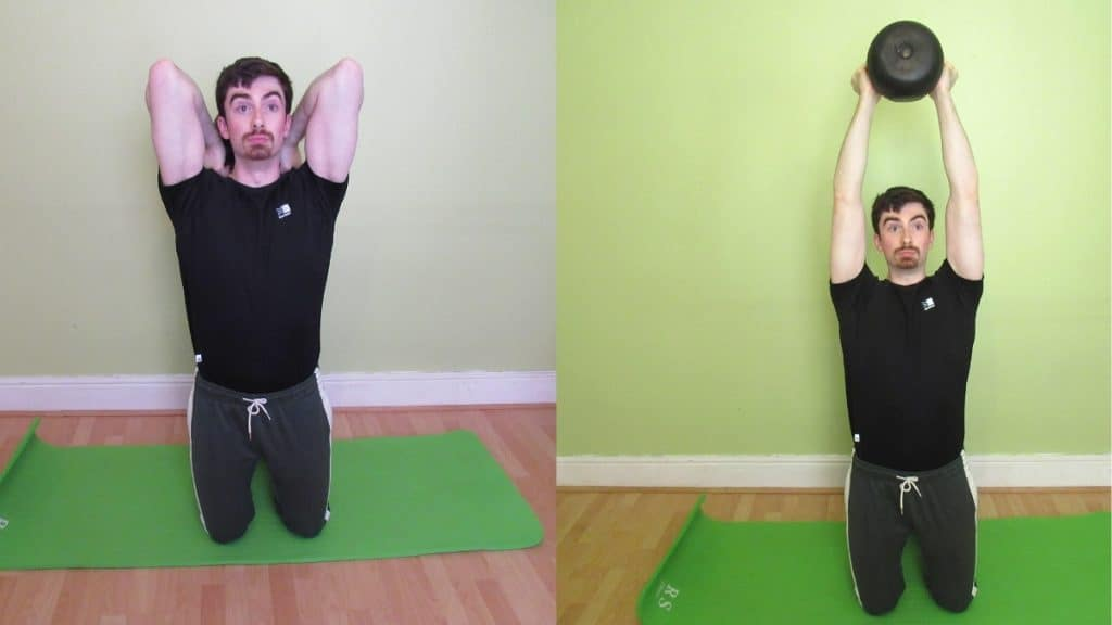 A man doing a kneeling kettlebell tricep extension