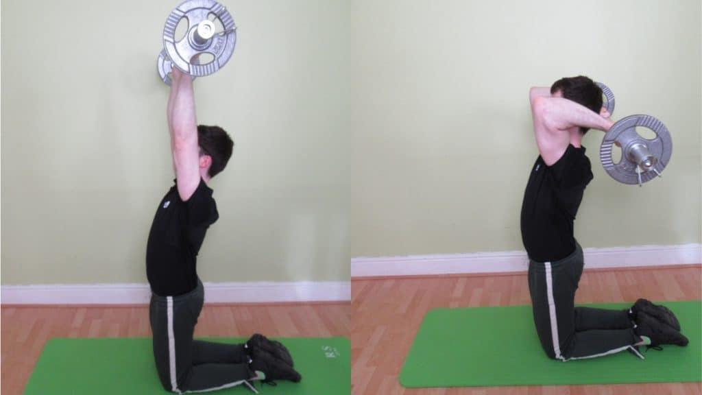 A man doing a kneeling overhead EZ bar tricep extension