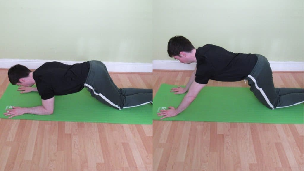 A man doing a kneeling plank to triceps extension