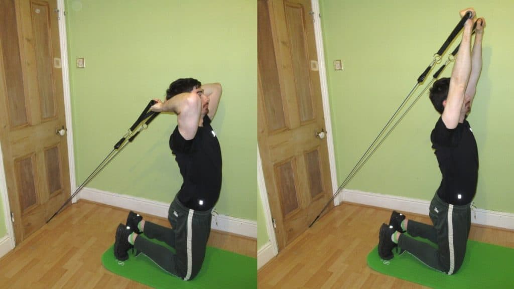 A man doing a kneeling resistance band tricep extension