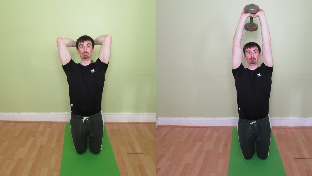 A man doing a kneeling triceps extension with a dumbbell