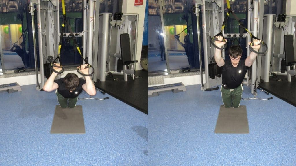 A man doing a kneeling TRX tricep extension at the gym