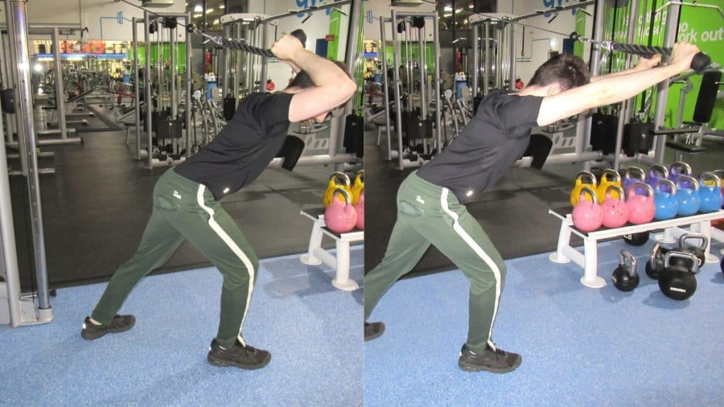 A man performing a leaning overhead tricep extension with a rope