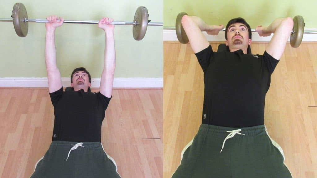 A man doing a lying barbell tricep extension