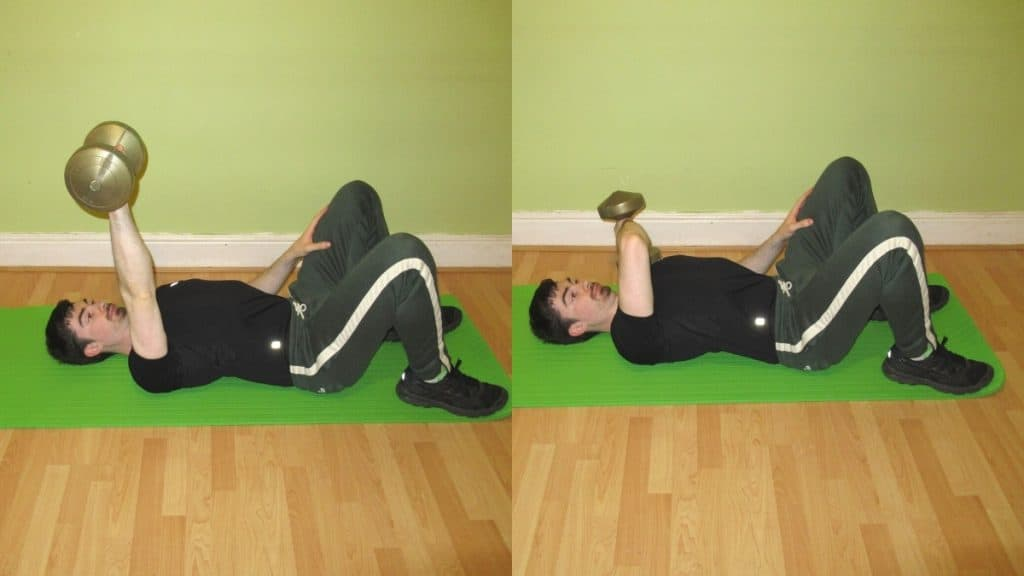 A man performing a one arm cross body tricep extension on the floor