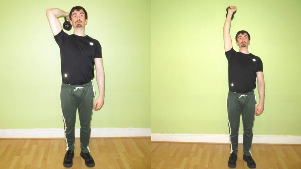 A man doing a one arm kettlebell tricep extension