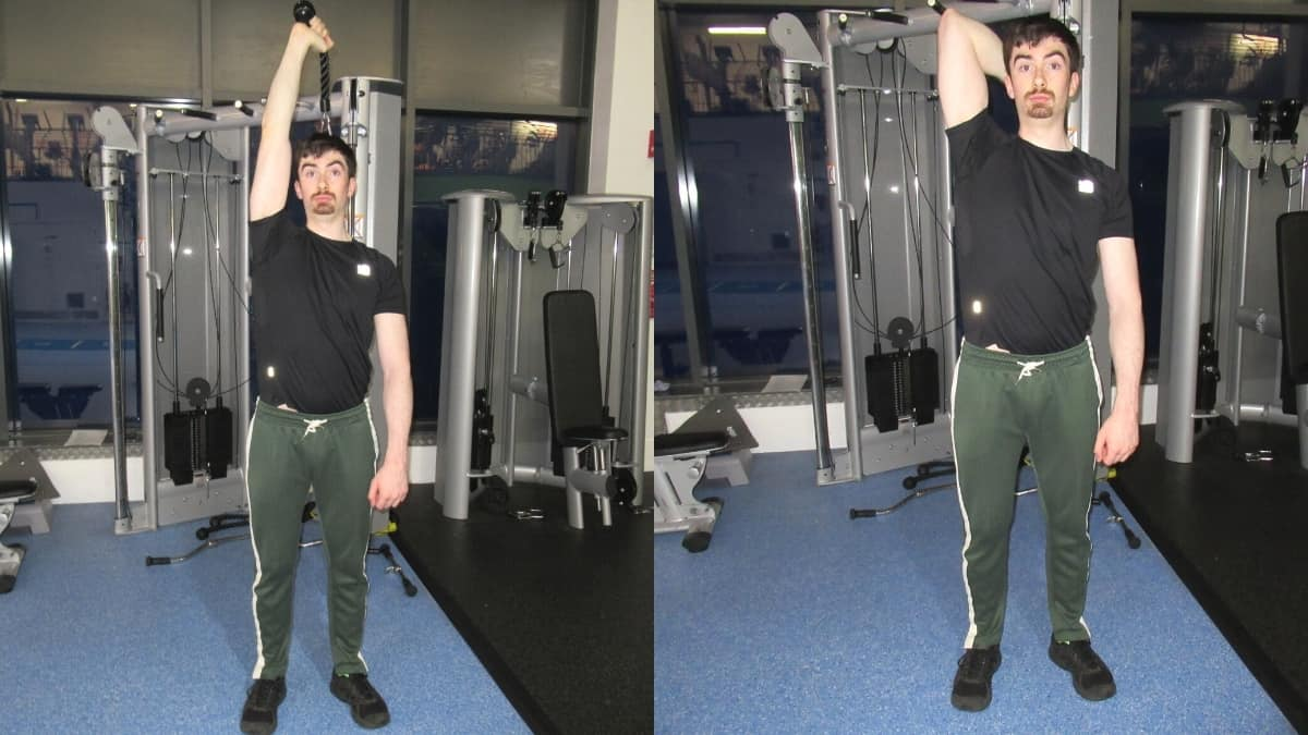 A man doing a one arm overhead cable tricep extension with a single rope