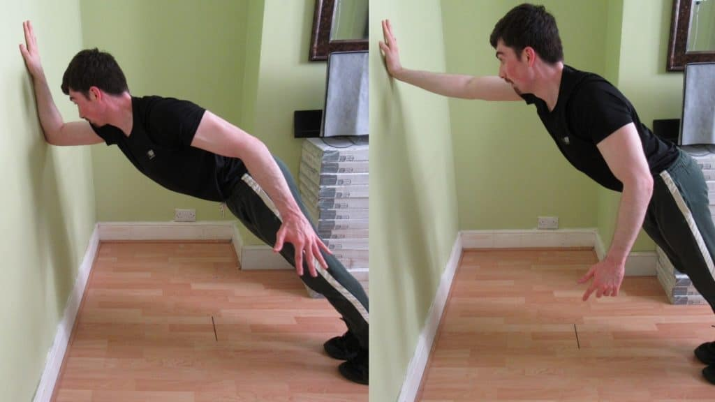 A man doing one arm wall tricep extensions