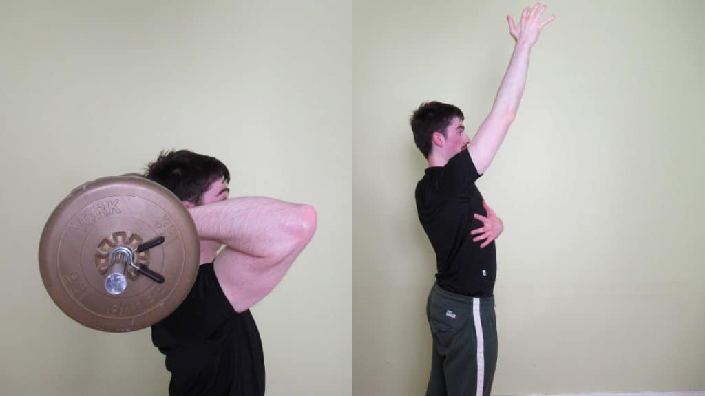 A man performing an overhead barbell tricep extension