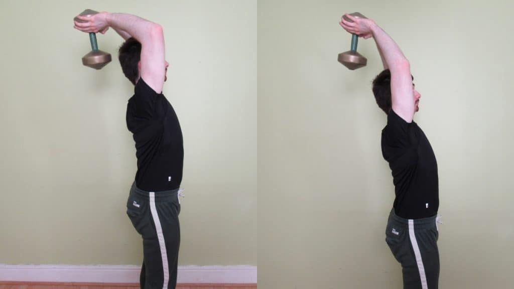 A man doing overhead DB extensions for his triceps