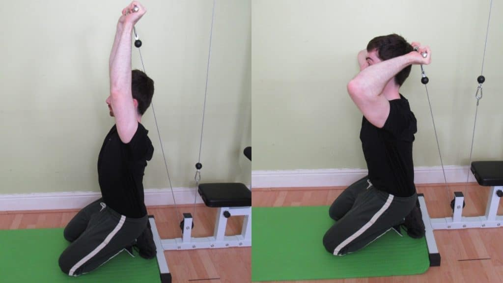A man doing an overhead kneeling cable triceps extension
