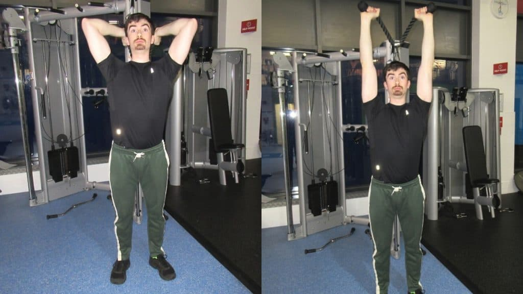 A man doing an overhead rope tricep extension at the gym using cables