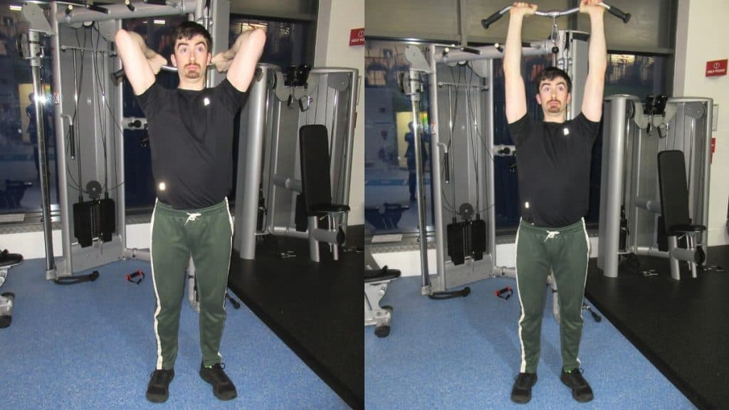 A man performing an overhead tricep extension with cables at the gym