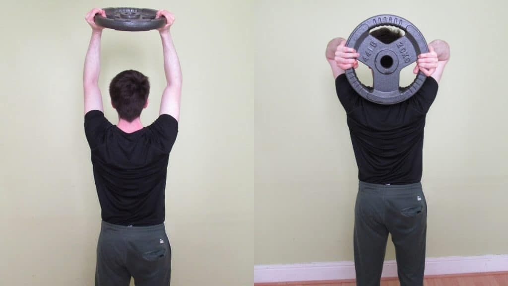 A man doing an overhead tricep extension with a weight plate