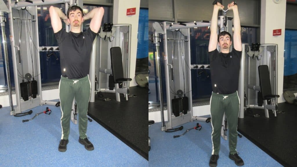 A man performing overhead v bar extensions for his triceps
