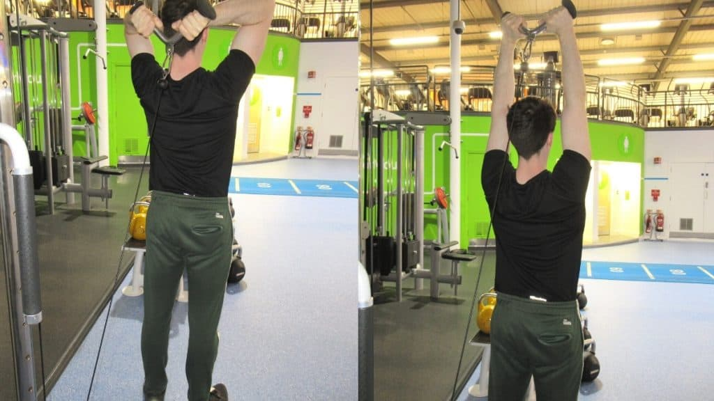 A man doing an overhead v bar tricep extension at the gym