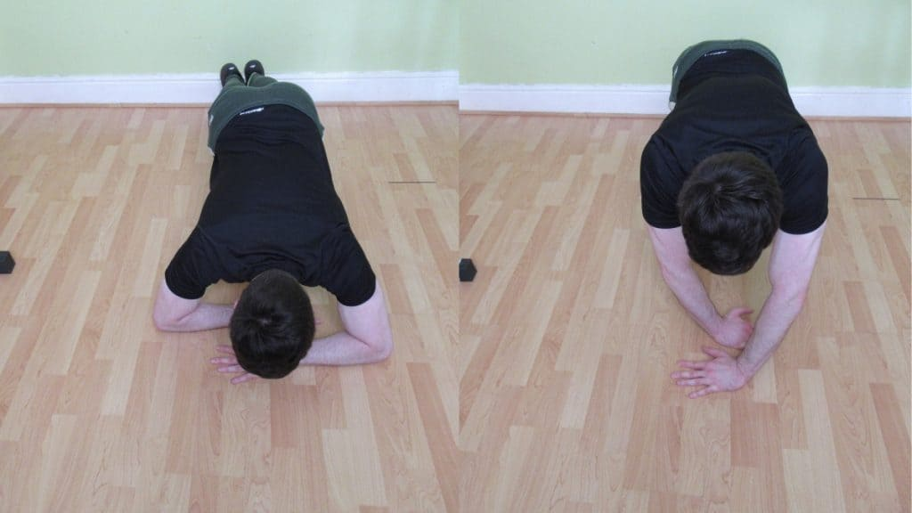 A man performing a plank with triceps extension with his arms crossed