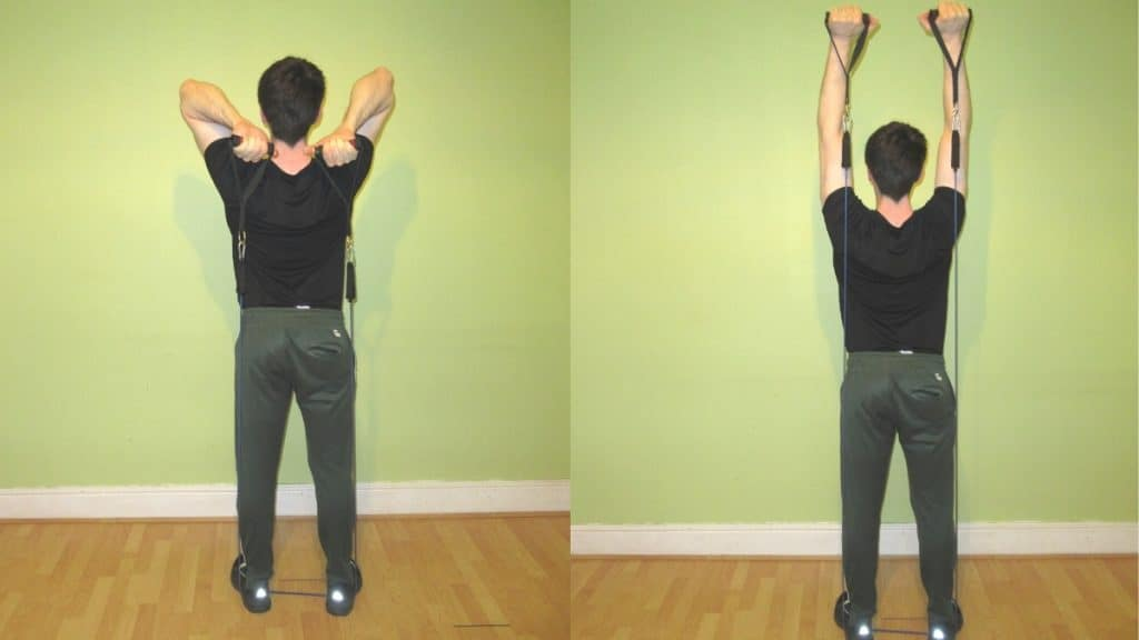 A man doing a resistance band overhead tricep extension
