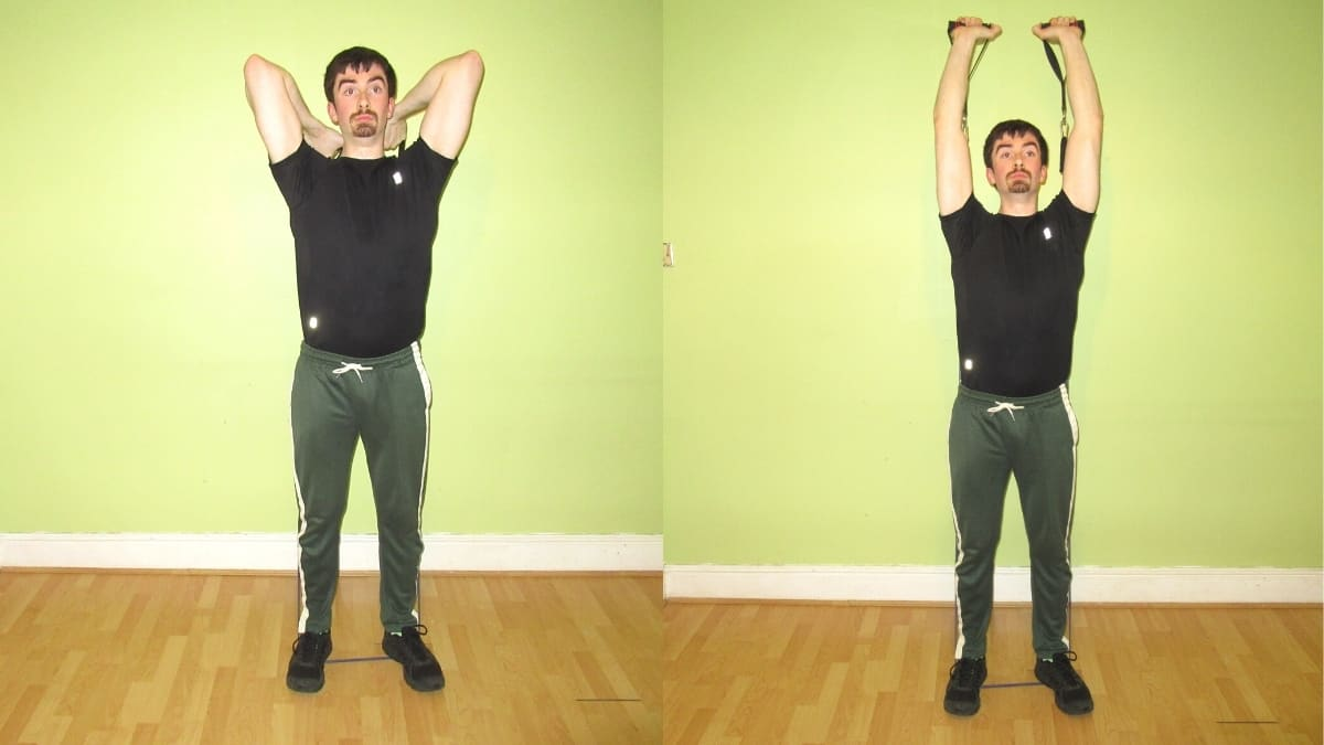 A man doing resistance band overhead tricep extensions