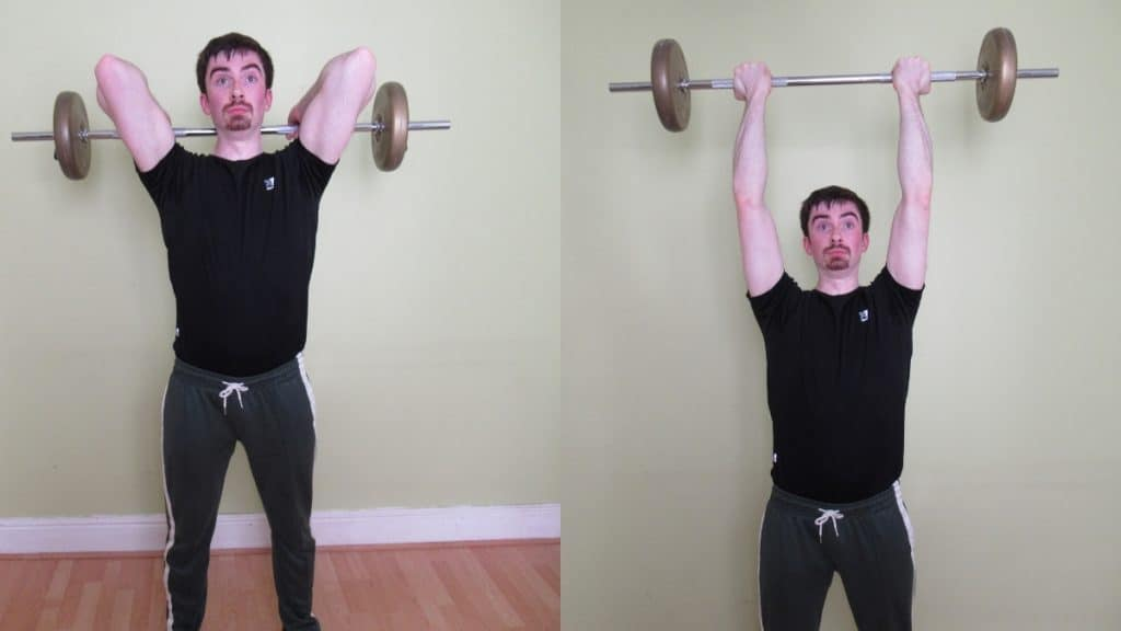 A man doing a reverse grip barbell tricep extension