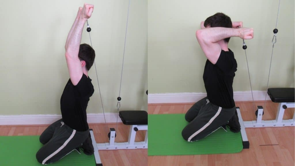 A man doing a reverse grip kneeling cable triceps extension