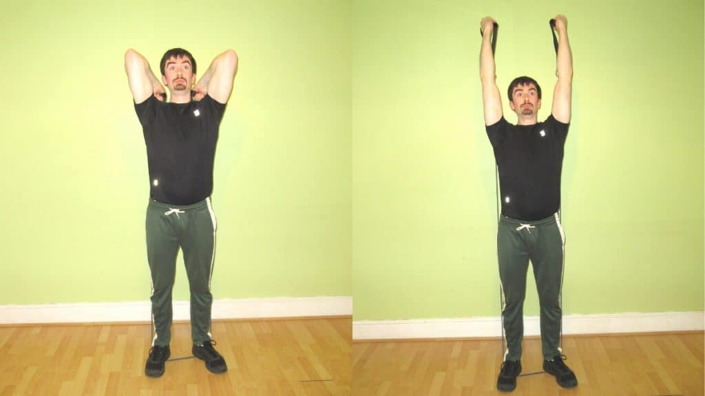 A man performing a reverse grip resistance band tricep extension