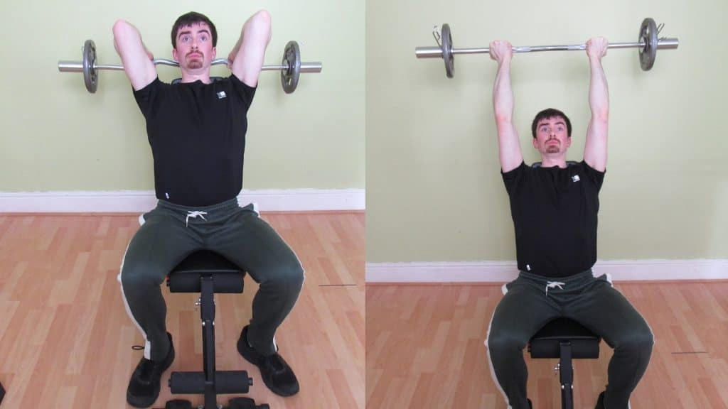 A man doing a reverse seated EZ bar tricep extension
